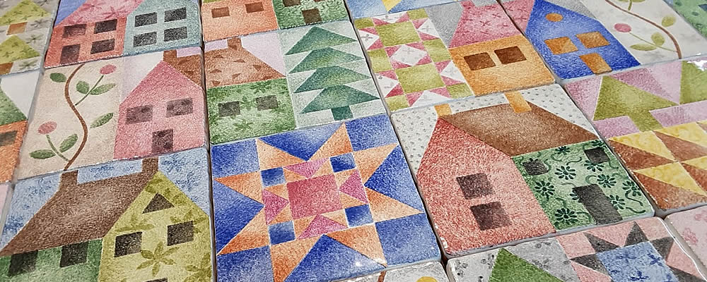Hand painted patchwork tile motifs