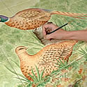 Finishing touches to a Pheasant Woodland Tiled Scene